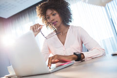Businesswoman working on her computer Stock Photos