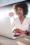 Businesswoman working on her computer Stock Images