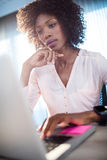 Businesswoman working on her computer Stock Photography