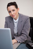 Businesswoman working at her desk Stock Images