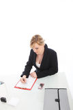 Businesswoman working at her desk Stock Image