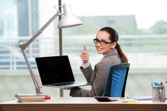 The businesswoman working at her desk Royalty Free Stock Image