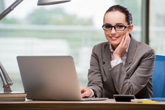 The businesswoman working at her desk Royalty Free Stock Photo