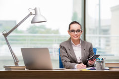 The businesswoman working at her desk Royalty Free Stock Images