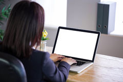 Businesswoman working at her desk on laptop Royalty Free Stock Photo