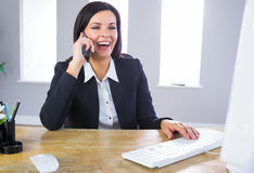 Businesswoman working at her desk Royalty Free Stock Photos
