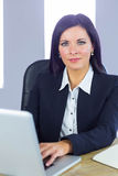 Businesswoman working at her desk Royalty Free Stock Image