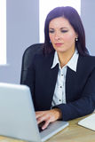 Businesswoman working at her desk Royalty Free Stock Photo