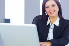 Businesswoman working at her desk Stock Photos