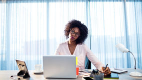 Businesswoman working on her desk Stock Image