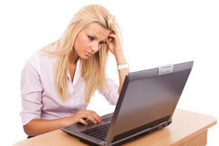 Businesswoman working at her laptop Stock Photos