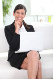 Businesswoman working on her laptop in lobby Royalty Free Stock Photos