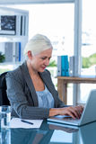 Businesswoman working with her laptop Royalty Free Stock Photography