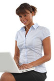 Businesswoman working on her laptop Stock Image