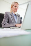 Businesswoman working on her notebook Royalty Free Stock Photo