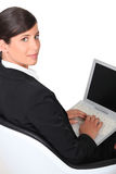 Businesswoman working on her notebook Royalty Free Stock Images