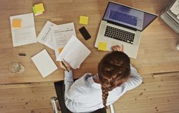 Businesswoman working at her office desk with documents and laptop Royalty Free Stock Photos