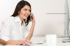 Businesswoman working in her office Stock Photography