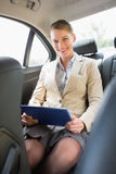 Businesswoman working on her tablet computer Stock Photo