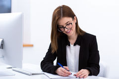 Businesswoman working at her workplace Royalty Free Stock Images
