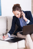 Businesswoman working at home Stock Image