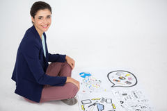 Businesswoman working on icon charts Stock Photography