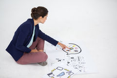 Businesswoman working on icon charts Stock Images