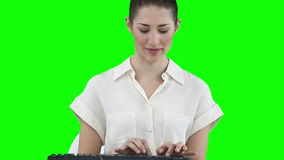 Businesswoman working on a keyboard Stock Photos