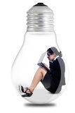 Businesswoman working in a lamp Stock Photo