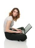 Businesswoman working on laptop Royalty Free Stock Photos
