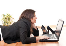 Businesswoman working on laptop Stock Images