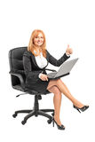 Businesswoman working on a laptop Stock Image