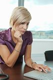 Businesswoman working with laptop Royalty Free Stock Photos