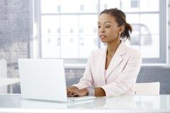 Businesswoman working on laptop royalty free stock photo