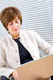 Businesswoman working on laptop stock image