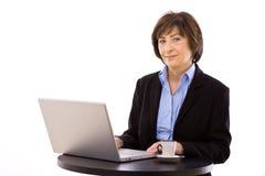 Businesswoman working on laptop Royalty Free Stock Image