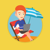 Businesswoman working on laptop at the beach. Royalty Free Stock Photo