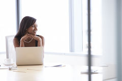 Businesswoman Working On Laptop At Boardroom Table Stock Image