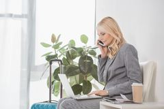 Businesswoman working with laptop Royalty Free Stock Photography