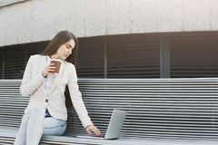 Caucasian businesswoman working with laptop outdoors Royalty Free Stock Photo