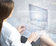 A businesswoman working on the laptop Stock Photography