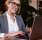 Businesswoman Working On Laptop In Coffee Shop. Young business w Stock Images