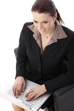 Businesswoman working on laptop computer Royalty Free Stock Photos