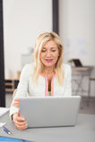 Businesswoman working on a laptop computer Royalty Free Stock Photo