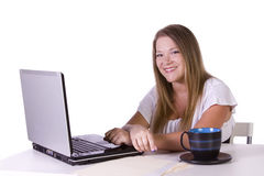 Businesswoman working on laptop with cup of coffee Stock Photo