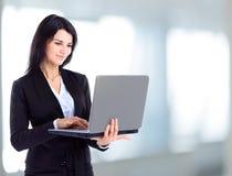 Businesswoman working at a laptop stock photos