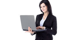 Businesswoman working at a laptop full length isolated, white background Royalty Free Stock Image