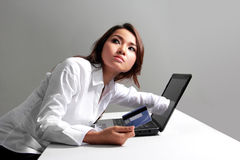 Businesswoman working with laptop holding credit card buying onl Stock Photos