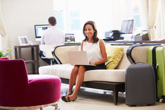 Businesswoman Working On Laptop In Hotel Lobby Stock Images