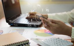Businesswoman working on laptop and mobile phone. Stock Photos